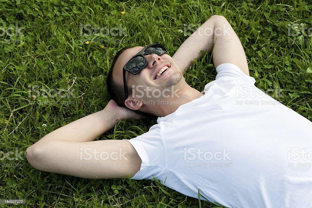 man lie on grass stock photo