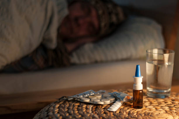A man lie with cold in your bed stock photo