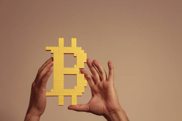 man lift up the bitcoin stock photo
