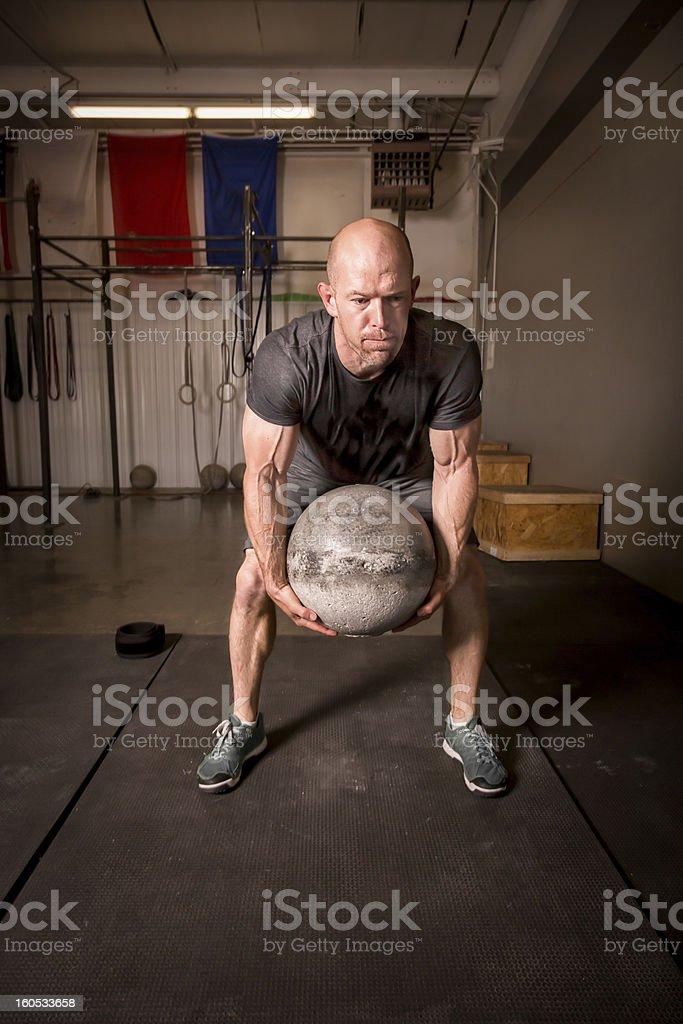 Man Lifting Atlas or Medicine Ball stock photo