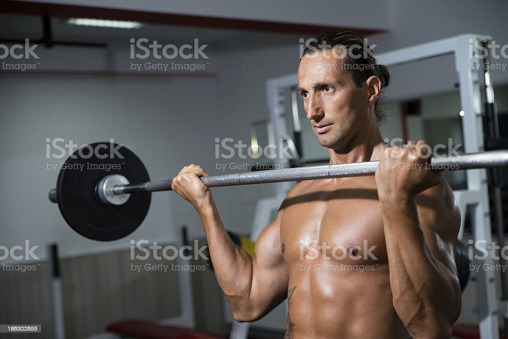 Man Lifting Barbell In Gym royalty-free stock photo