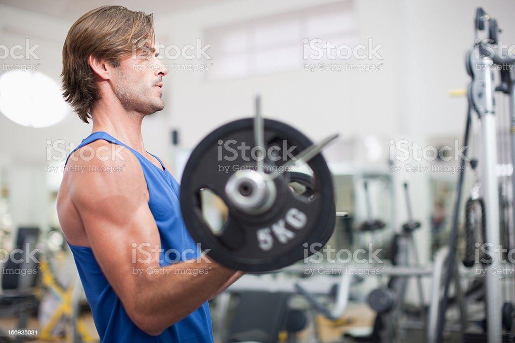 Man lifting barbell in gymnasium royalty-free stock photo