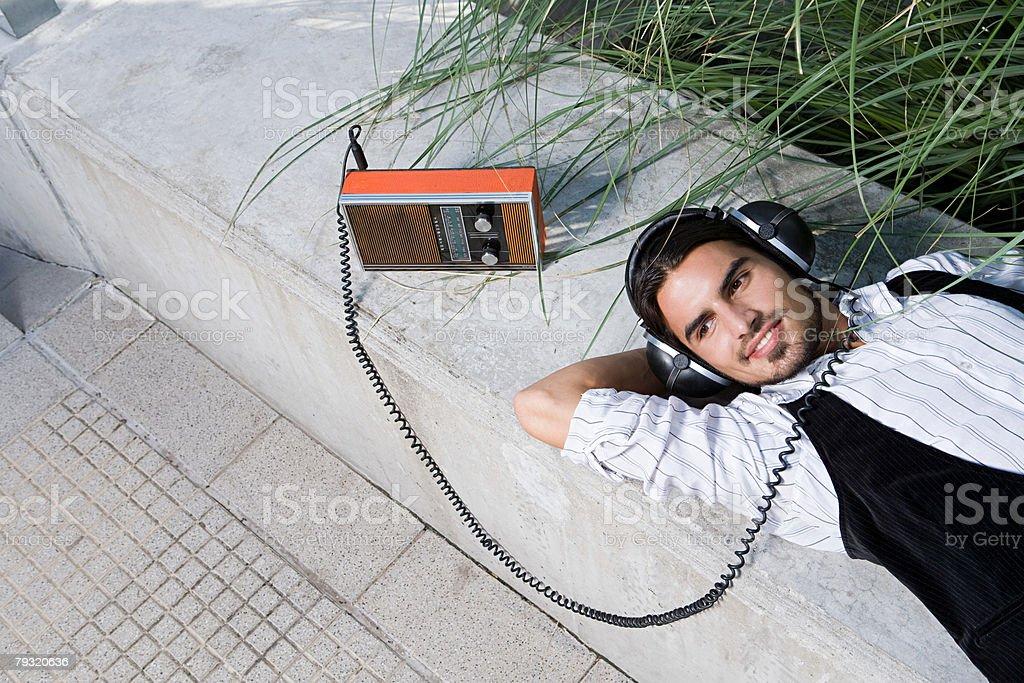 Man listening to a retro radio
