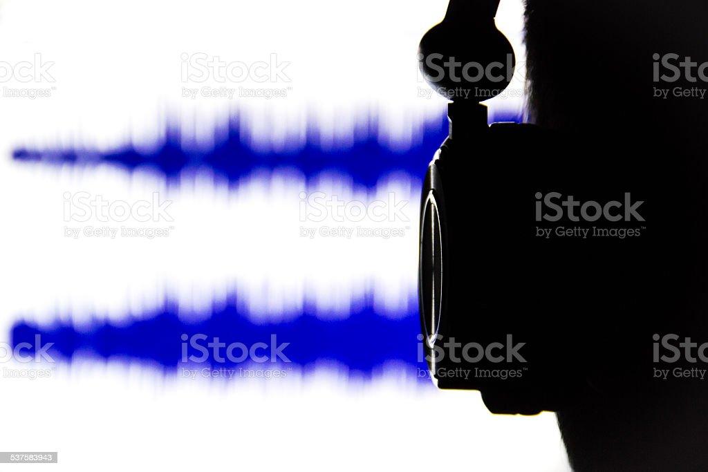 Man listening to an audio recording stock photo