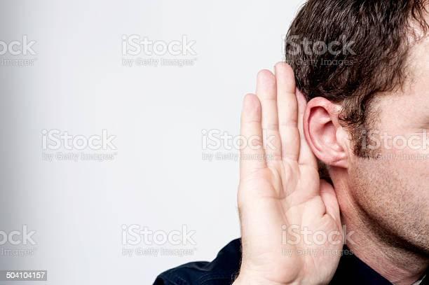 Man Listening To Gossip Stock Photo - Download Image Now