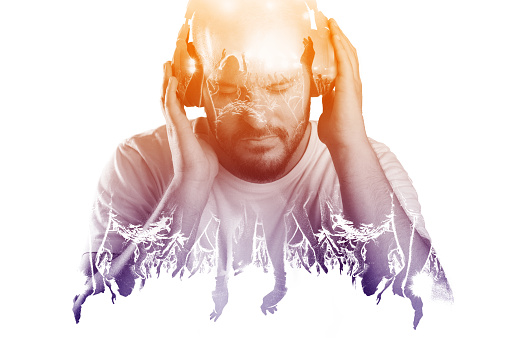 Man listening to music via earphones. Live music experience concept.