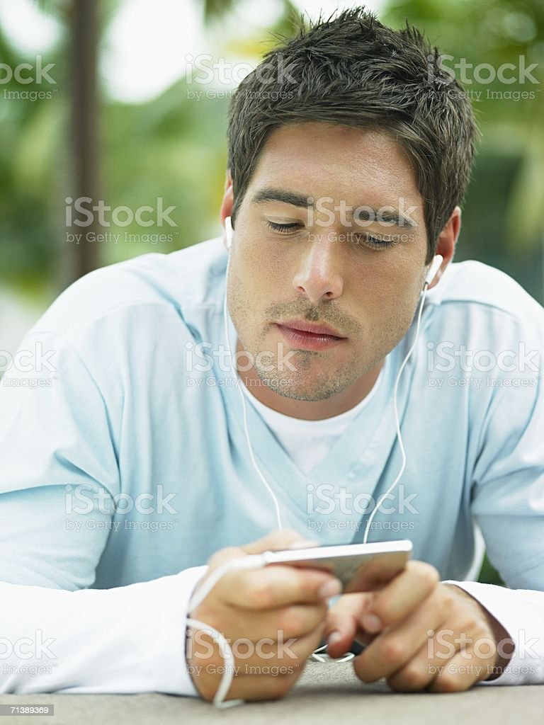 Man listening to music on an mp3 player royalty-free stock photo