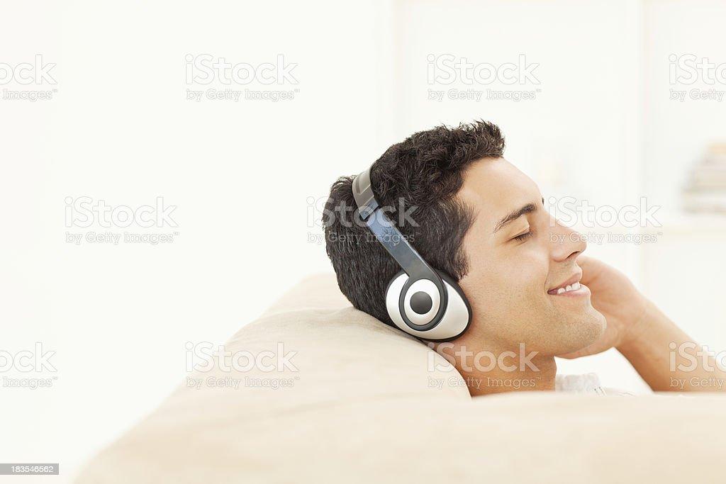 Man Listening to Music on Headphones royalty-free stock photo