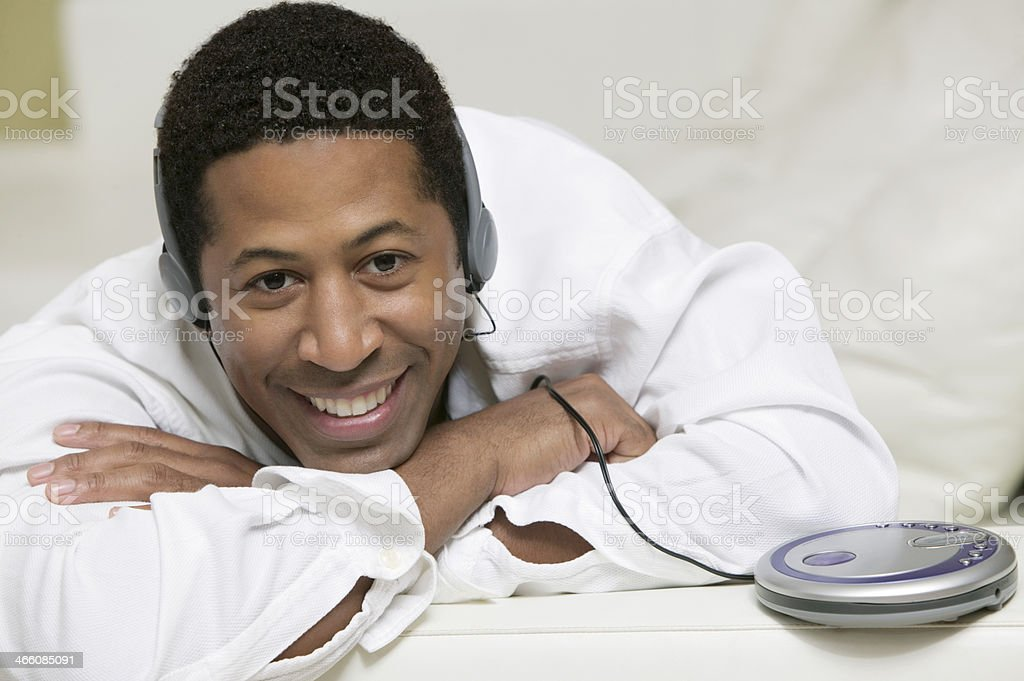 Man Listening to Music on Headphones stock photo