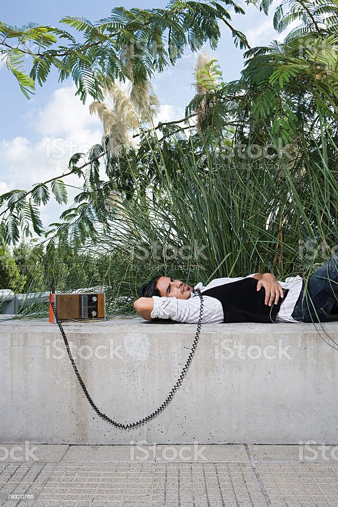 Man listening to radio on a wall 免版稅 stock photo