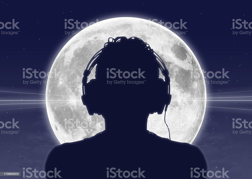man listening to the music at full moon royalty-free stock photo