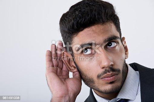 Man secretly listening on private conversation