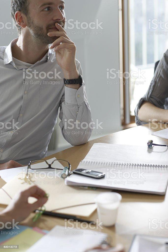 man listens during office meeting royaltyfri bildbanksbilder