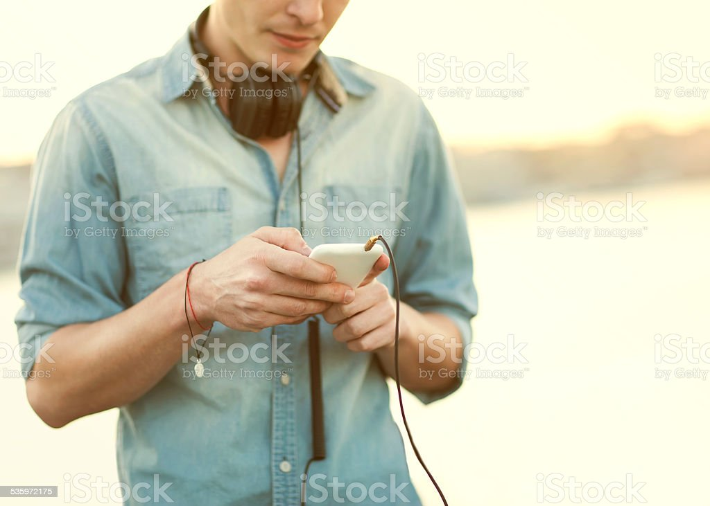 man listens to the player on the street stock photo