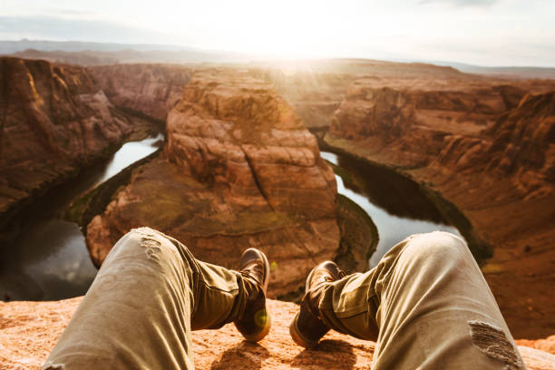 man living on the edge at the horseshoe bend stock photo