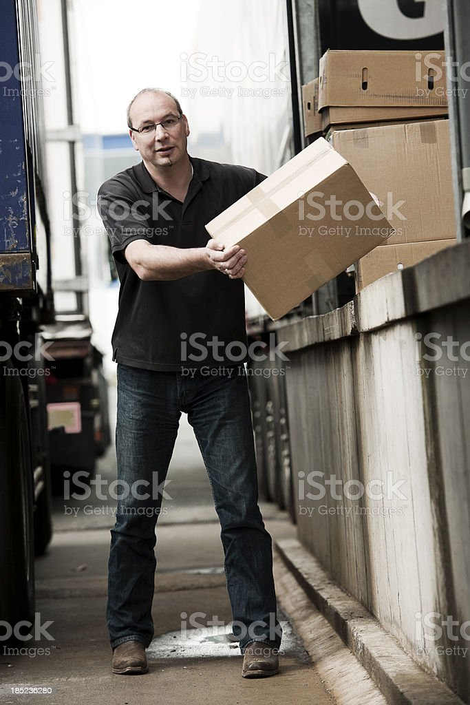 Man loading a truck royalty-free stock photo