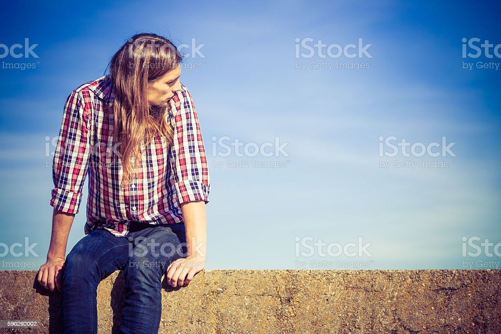Man long hair relaxing outdoor sky background royaltyfri bildbanksbilder