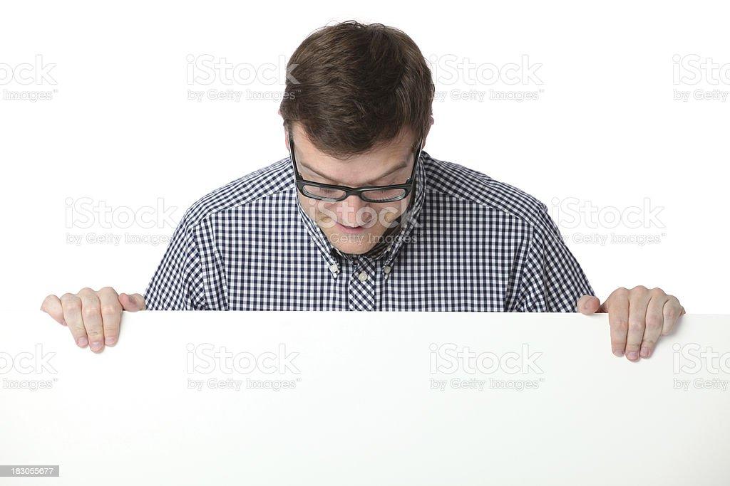 Man looking at a placard royalty-free stock photo