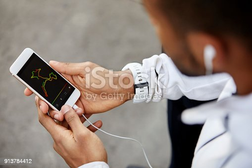 istock Man looking at analysis on screen of smart phone 913784412