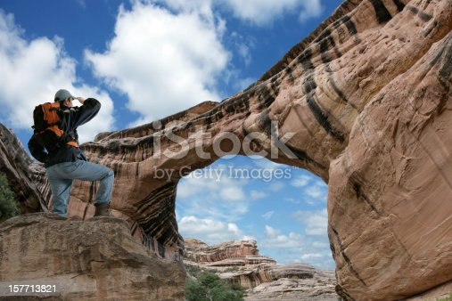 903015102istockphoto XXXL man looking at arch 157713821