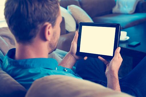 Man looking at blank digital tablet.