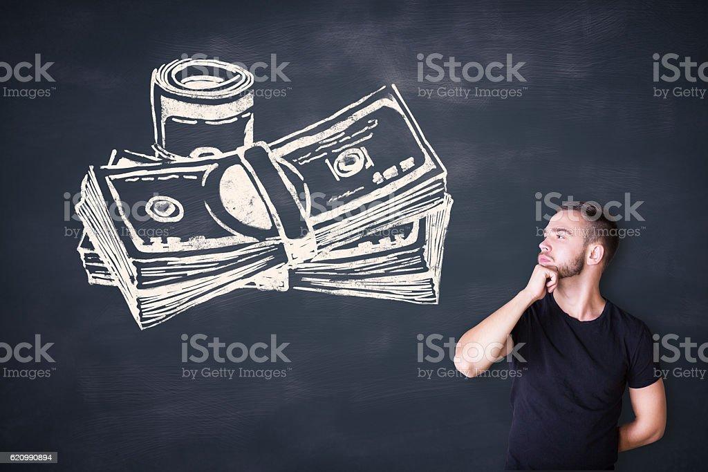 Man looking at cash sketch foto royalty-free