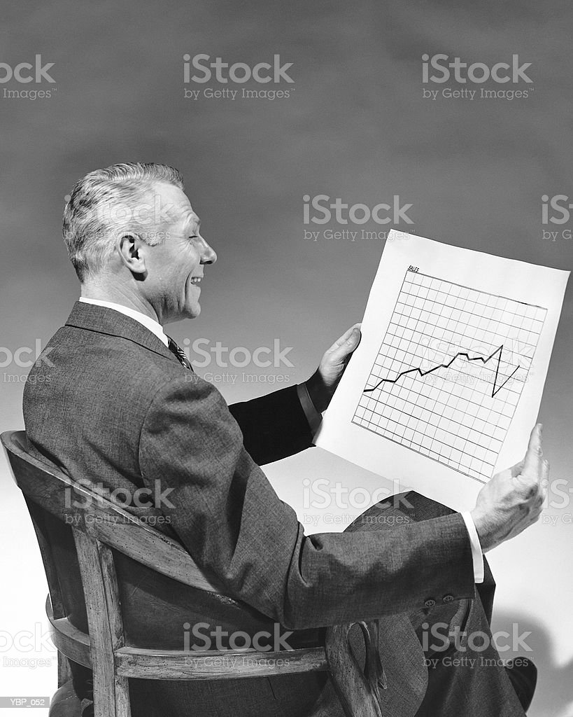 Man looking at chart royalty-free stock photo