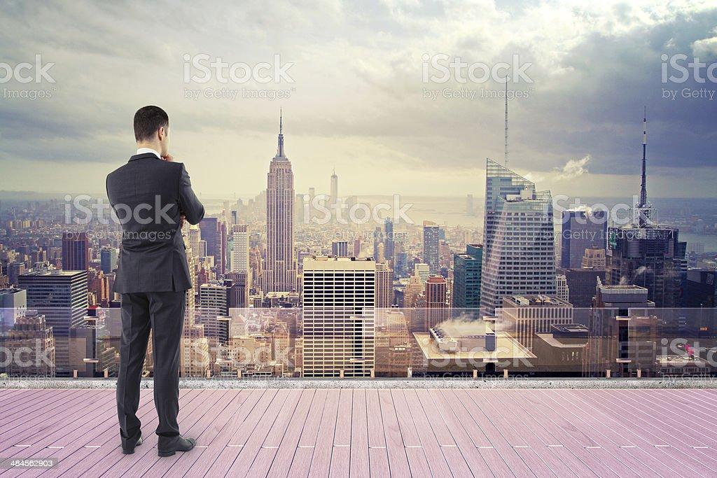 man  looking at city stock photo