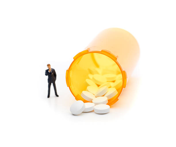 man looking at drugs - fda stock photos and pictures