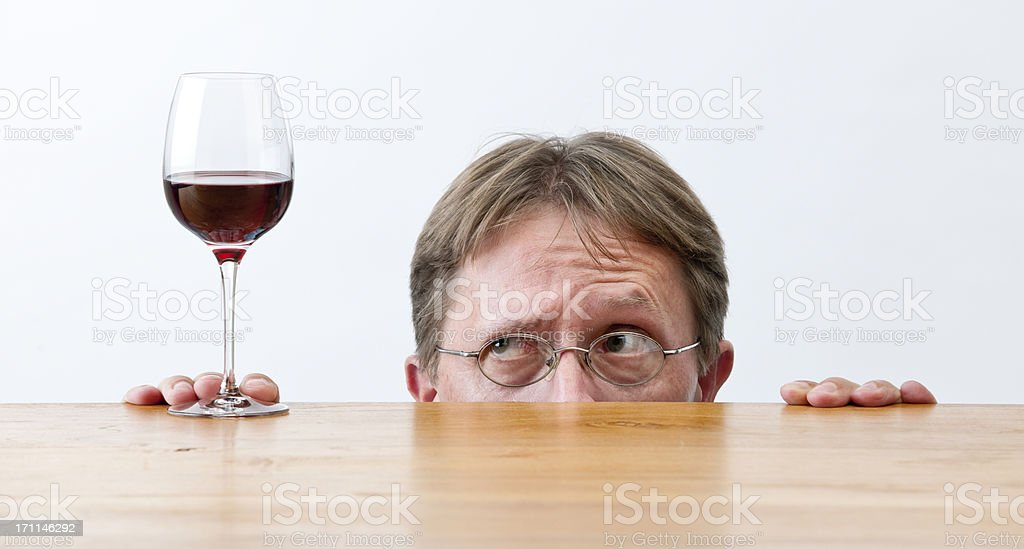 man looking at glass of red wine XXL royalty-free stock photo