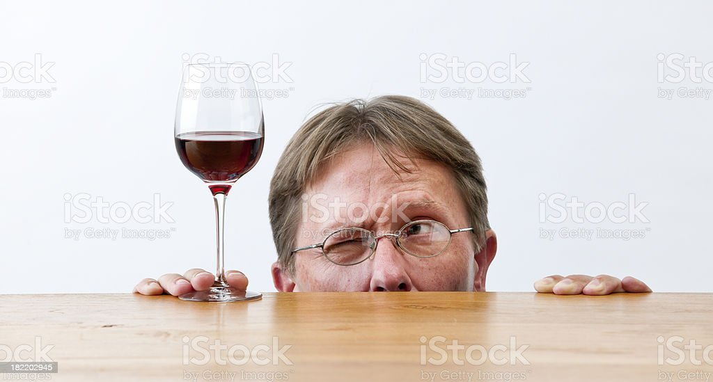 man looking at glass of red wine XXL stock photo