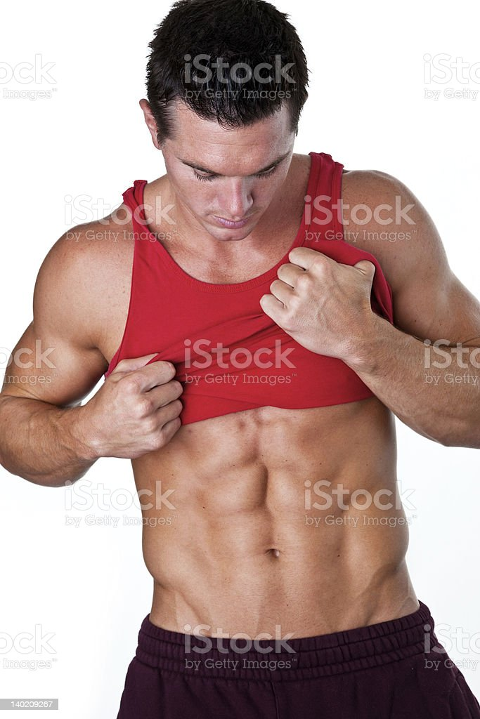 Man looking at his 6 pack abs royalty-free stock photo