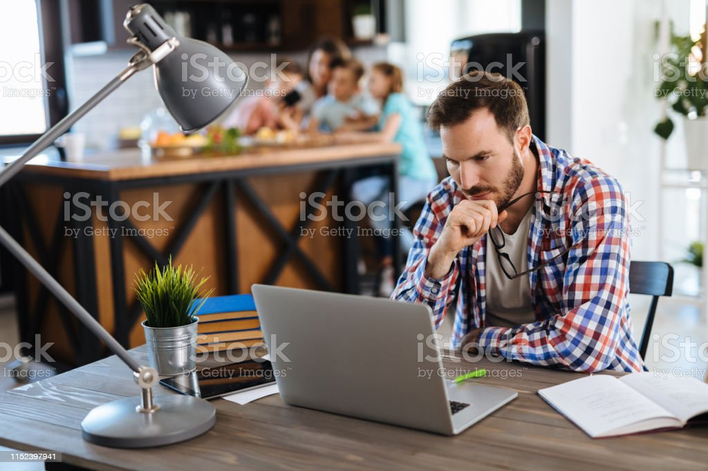 Man looking at his monthly bills at home