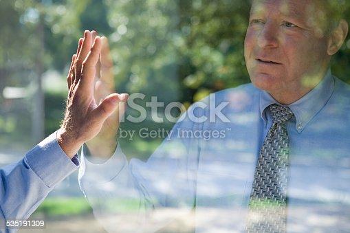 istock Man looking at his reflection 535191309