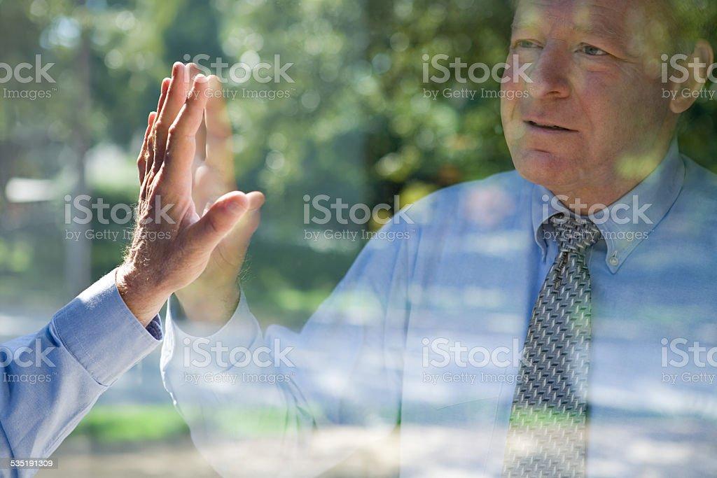 Man looking at his reflection stock photo