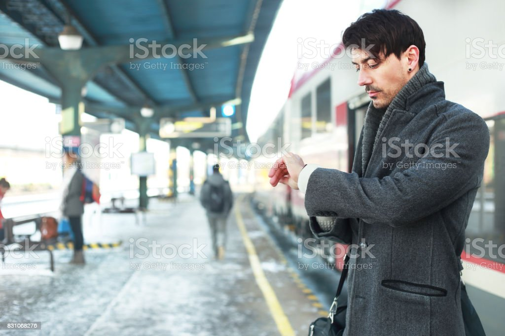 man looking at his watches stock photo