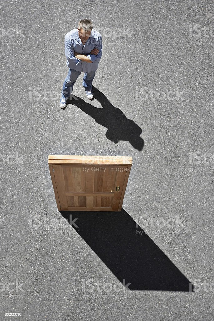 Man looking at isolated door stock photo