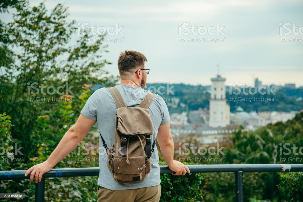 man looking at old european city stock photo