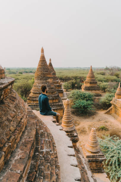 Man looking at scenic  view of Bagan Heritage Site from above stock photo