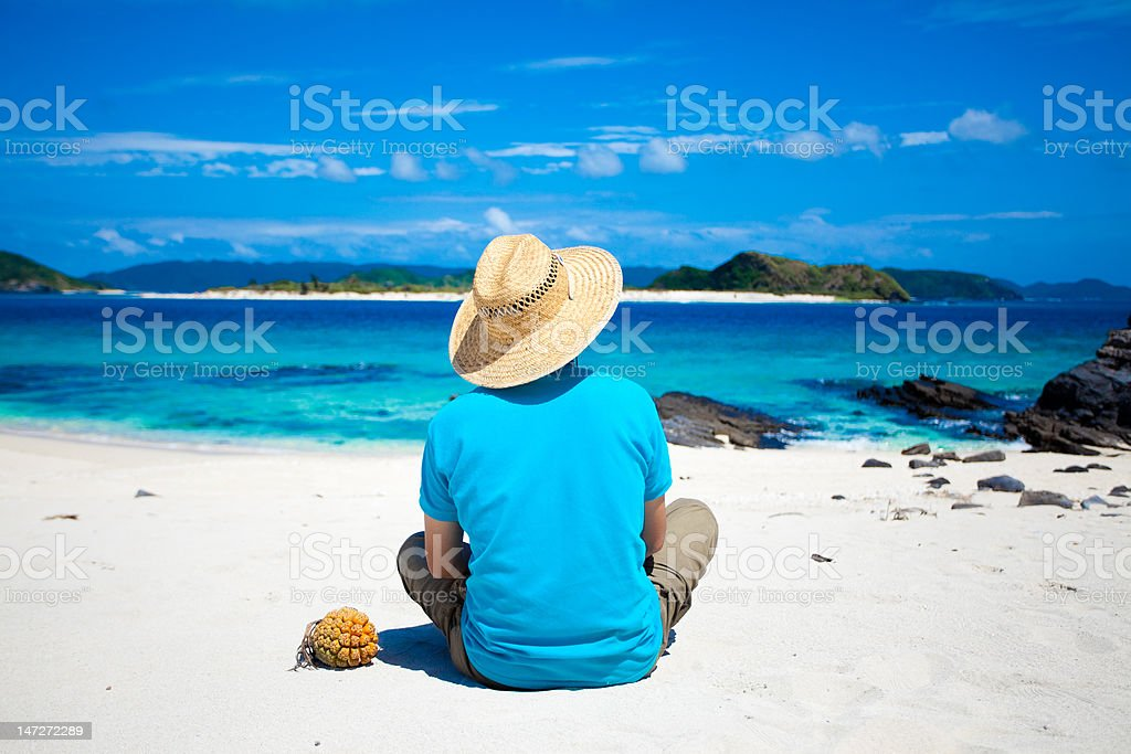 Man looking at the coral island in Japan royalty-free stock photo