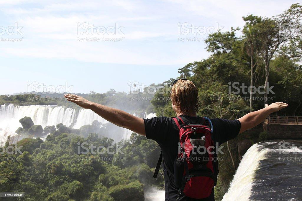 Man Looking at the Iguacu Waterfalls, Argentina royalty-free stock photo