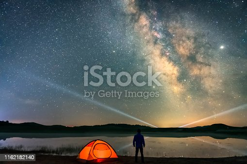 Man looking at the Milky Way galaxy