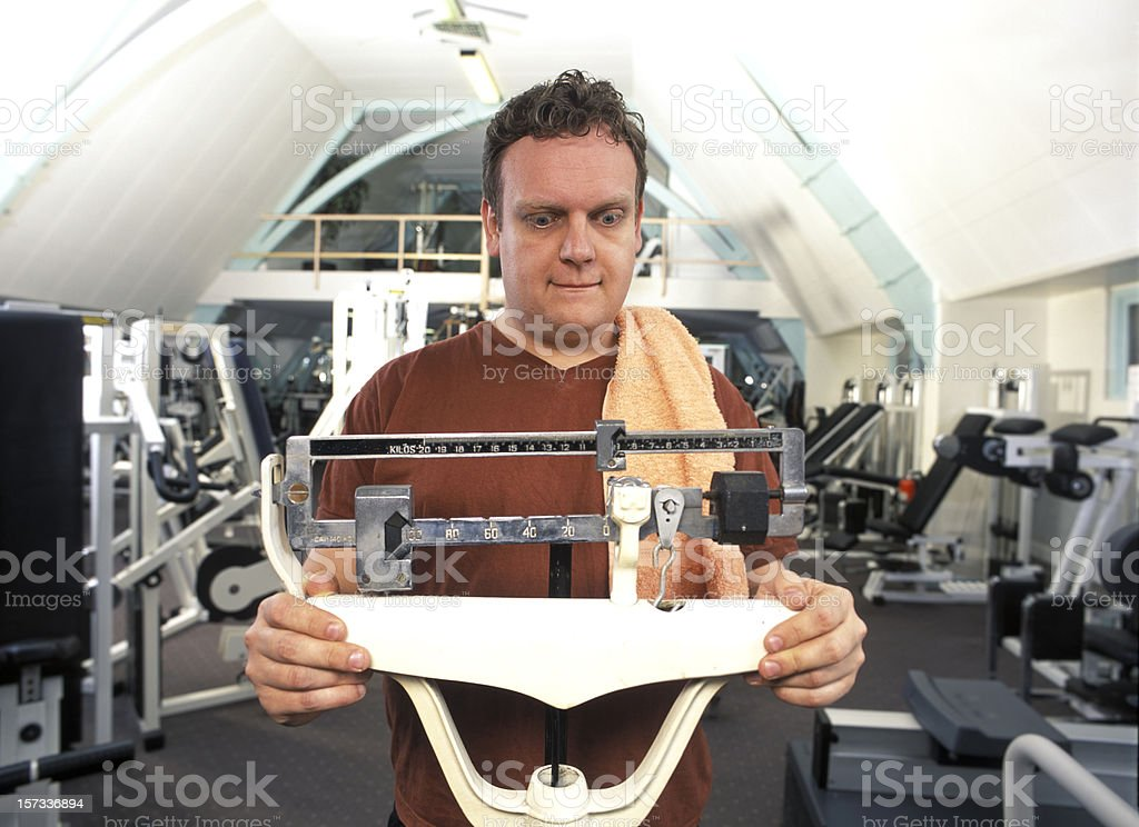 man looking at the scale numbers stock photo