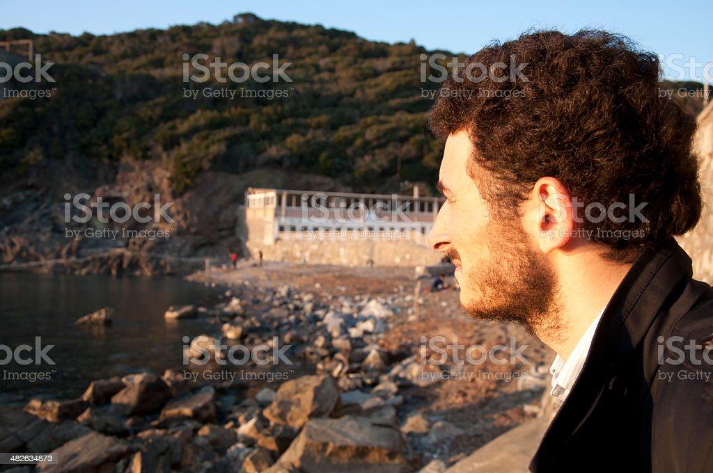 Man looking at the sea stock photo