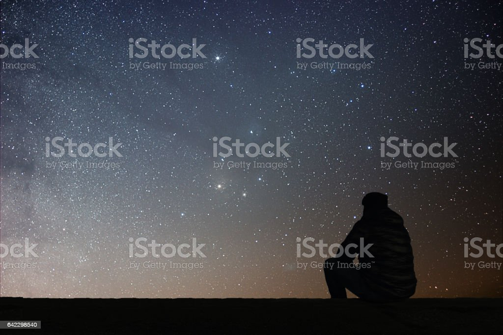 Man looking at the stars stock photo