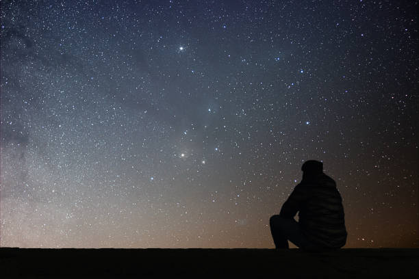 Man looking at the stars stock photo