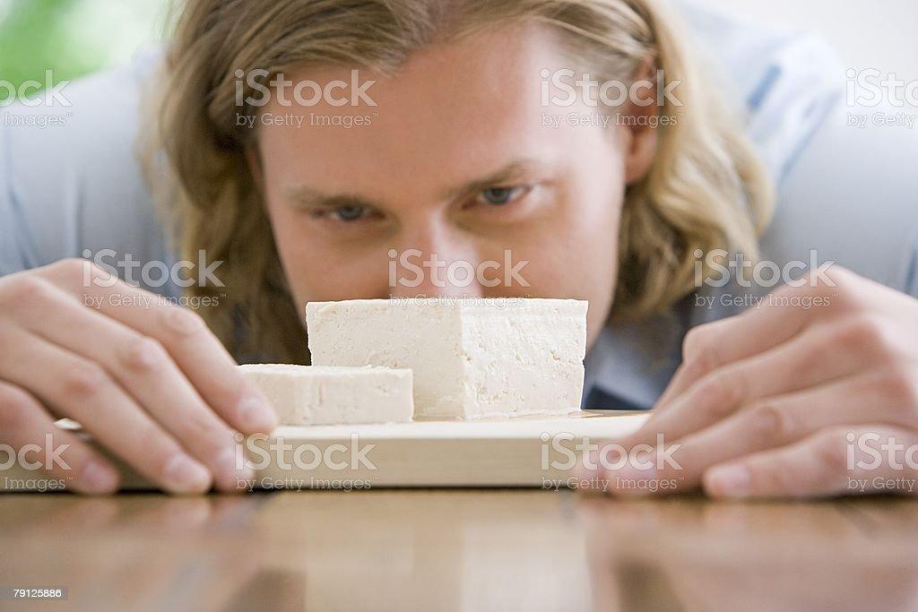 A man looking at tofu 免版稅 stock photo