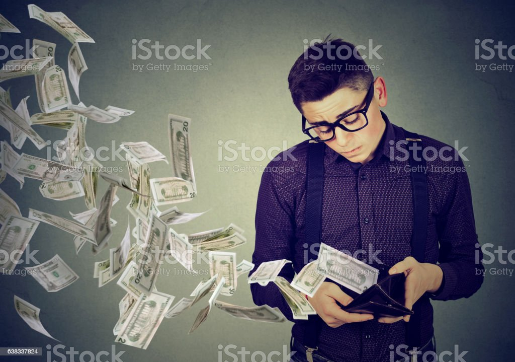 Man looking at wallet money dollar banknotes flying away stock photo