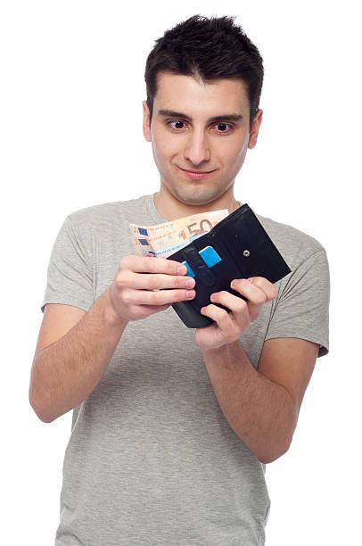 Man looking at wallet stock photo