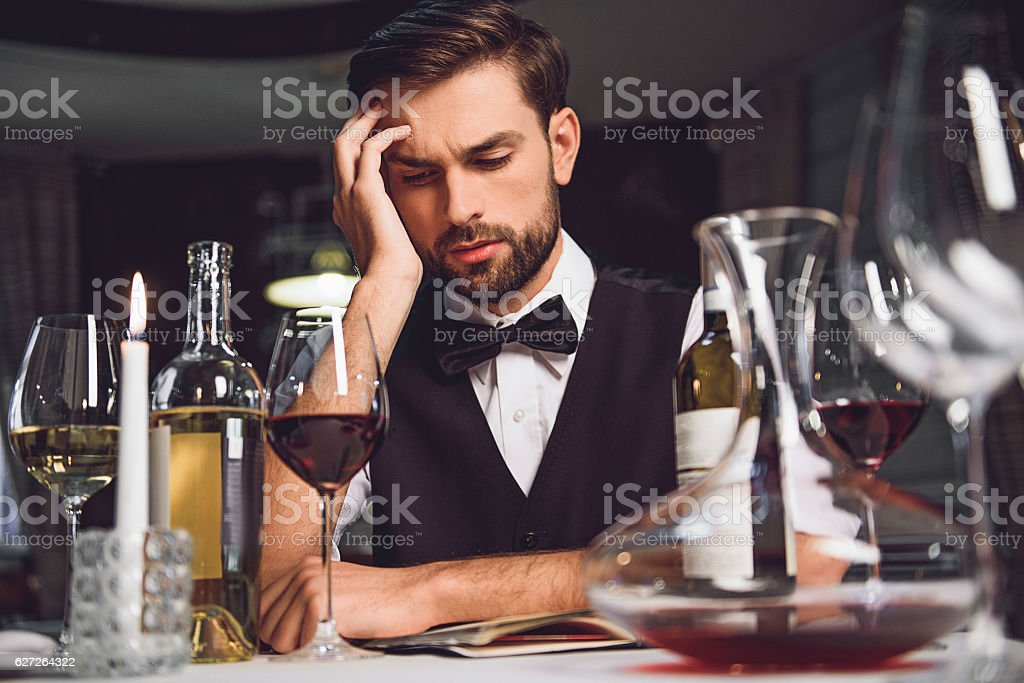 Man looking at wine with lost sight stock photo